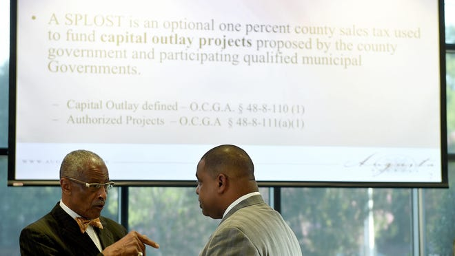 Augusta Commissioner Marion Williams, left, and Sheriff Richard Roundtree talk at a 2015 open house on SPLOST 7, a 1% sales tax used to fund capital projects. Commissioners are now finalizing the project list for SPLOST 8.