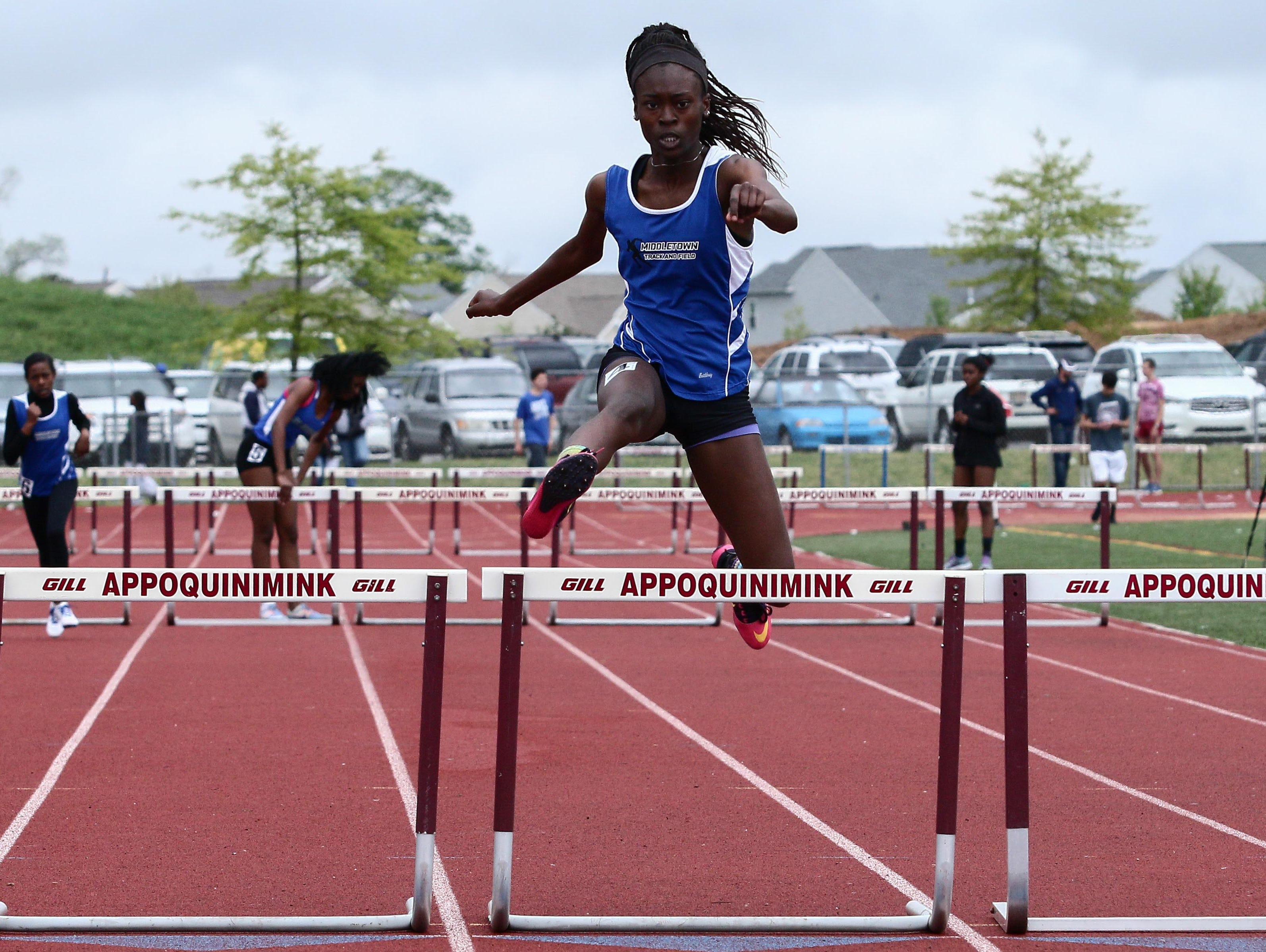 Middletown Ayo Fisher clears the last hurdle in the course of the Girls 100-Meter Hurdles during the Blue Hen Conference track and field meet Saturday.