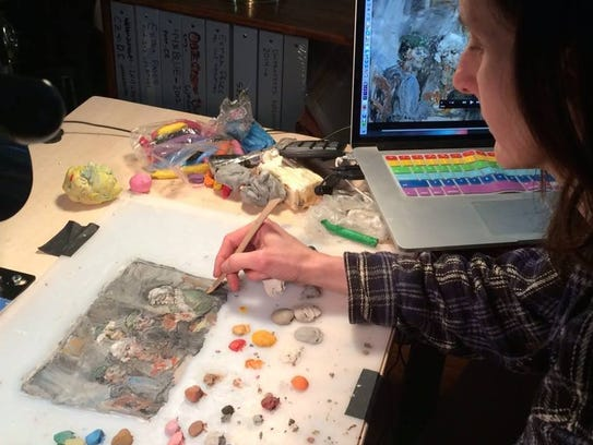 "Lynn Tomlinson ""paints"" using clay to create her film,"