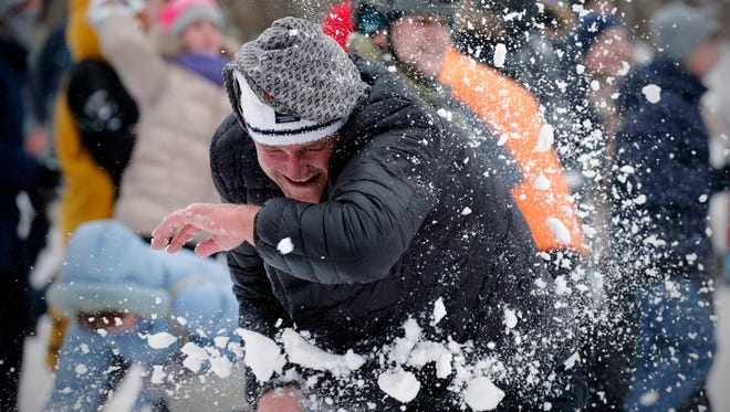 People enjoy a snowball battle in St. Petersburg, Russia, on Feb. 28. No matter how bad things get, Russians manage to carry on.