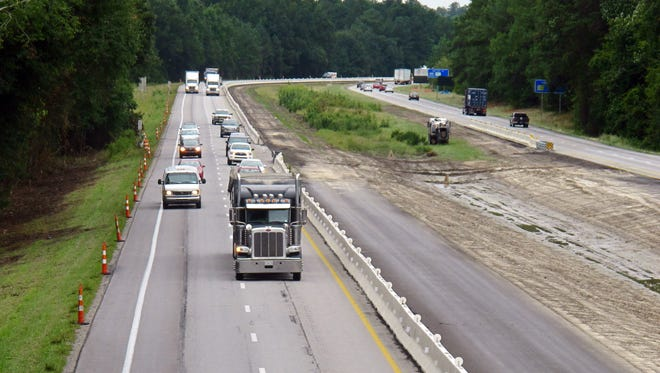 Traffic moves along a section of Interstate 26 in southwest of Columbia, S.C., on Wednesday, Sept. 24, 2014.