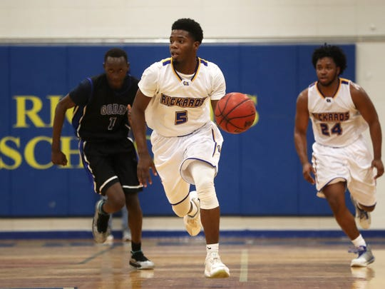 Rickards's Vincent McCray brings the ball upcourt against Godby in the Raiders 67-56 Region 1-6A semifinal win on Tuesday.
