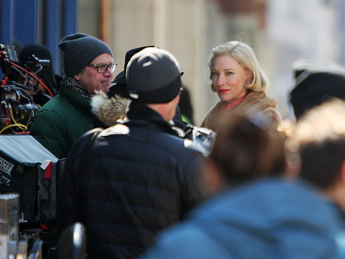 """Academy award-winning actress Cate Blanchett works on a scene during the filming of """"Carol,"""" a movie set in the 1950s in New York. It's directed by Todd Haynes, at left, in glasses. The production was filming on 12th and Walnut in Over-The-Rhine."""
