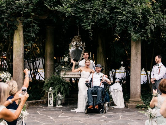 Megan Alexander and Brett Greenhill were married Sept. 9, 2017, in Atlanta, about nine months after a diving accident near the Naples Pier left Greenhill paralyzed from the neck down.