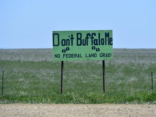 Signs opposing bison are posted along county roads en route to the American Prairie Reserve's bison range.