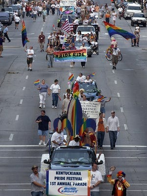 The Kentuckiana Pride Festival parade made its way down Main Street in 2004, the first year of the parade and the third year of the festival.