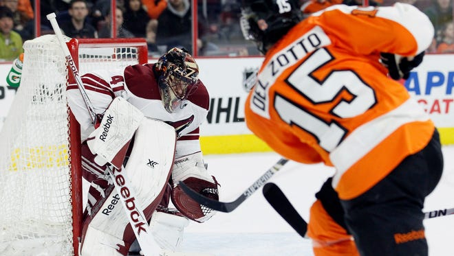 Philadelphia Flyers' Michael Del Zotto shoots and scores past Arizona Coyotes goalie Mike Smith in the second period on Jan. 27, 2015, in Philadelphia.