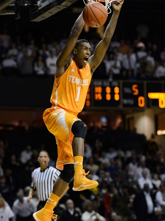 FILE - In this Feb. 5, 2014, file photo, Tennessee guard Josh Richardson (1) opens the game with a breakaway dunk in the first half of an NCAA college basketball game against Vanderbilt, in Nashville, Tenn. Richardson is the lone returning starter and one of only four returning scholarship players from the Tennessee team that went 24-13 and reached an NCAA regional semifinal last season. (AP Photo/Mark Zaleski, File)