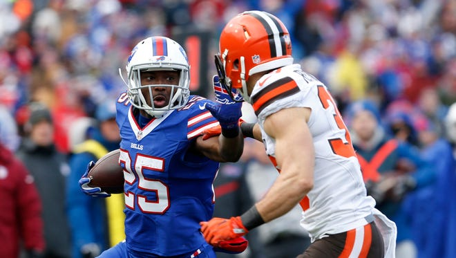 Dec 18, 2016; Orchard Park, NY, USA; Buffalo Bills running back LeSean McCoy (25) tries to block Cleveland Browns free safety Ed Reynolds (39) as he runs the ball during the first half at New Era Field. Mandatory Credit: Timothy T. Ludwig-USA TODAY Sports