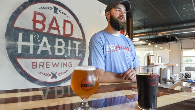 Aaron Rieland, founder of Bad Habit Brewing Co., is finishing up the taproom and getting equipment installed Wednesday in St. Joseph.