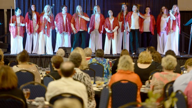 Women of Hope residents sing a song during the 2015 Women of Hope Gala, Tuesday evening.