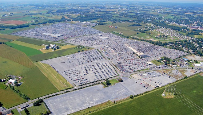 An aerial view shows thousands of vehicles parked on nearly 500 acres of the Manheim Auto Auction in Lancaster County. Route 72, which passes the auction, can be seen at the bottom of the photo.