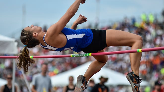 Paula Wollenslegel jumps during the Division II state final at Jesse Owens Memorial Stadium in Columbus as a senior.