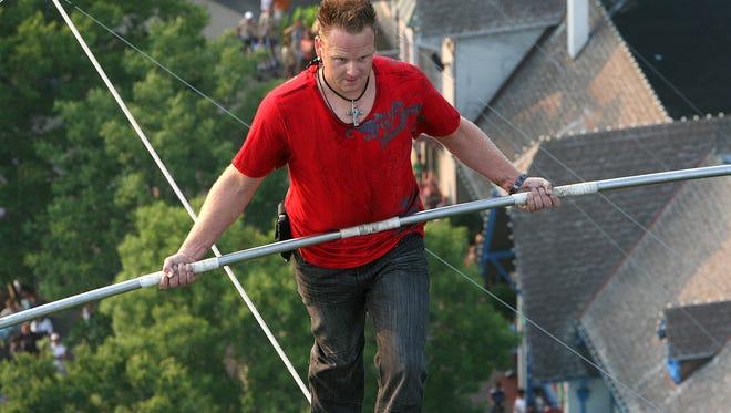Aerialist Nik Wallenda walks across a tightrope without a safety harness in Cincinnati in 2009.