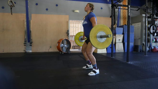 Former Foothill high school student Kaitlyn Jarret works out Friday at CrossFit Redding.