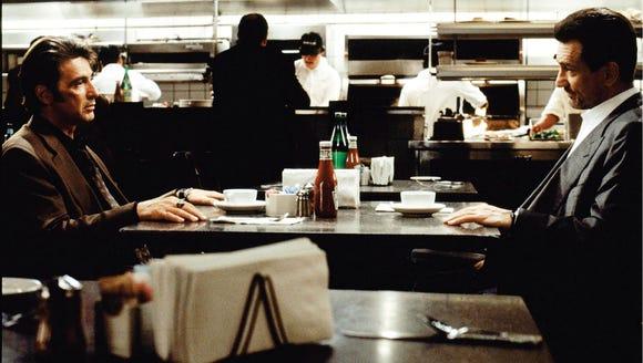 Al Pacino, left, stars as LAPD detective Vincent Hanna