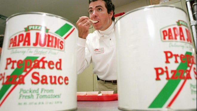 Papa John's founder John Schnatter tastes a spoonful of pizza sauce Tuesday, May 20th, 1997, in Louisville.