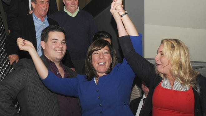 Sue Serino is flanked by her son, Anthony, left, and campaign aid, Krista Gobins, right, at Cosimo's restaurant after winning the New York State 41st Senate District Tuesday night.