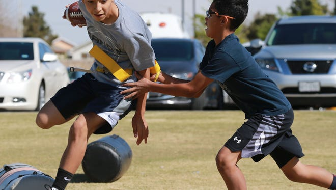 Jeremiah Viera, left, tries to elude defender Nathan Espinoza.