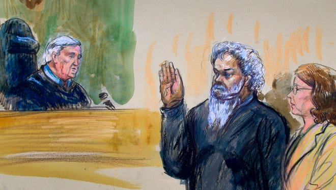 This artist's rendering shows United States Magistrate, Judge John Facciola, swearing in the defendant, Libyan militant Ahmed Abu Khatallah, at a federal court hearing on Saturday.