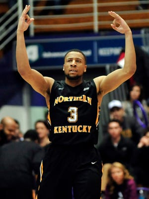 Northern Kentucky guard Tyler White gestures after making a 3-point basket against Northwestern on Dec. 27, 2014.