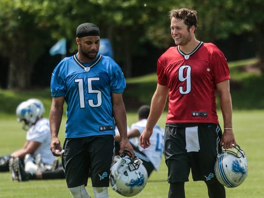 Detroit Lions WR Golden Tate III talks with QB Matthew Stafford while leaving practice at the Detroit Lions Headquarters & Training Facility in Allen Park on Thursday June 2, 2016.
