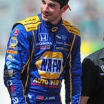 Rossi stuns at Indy