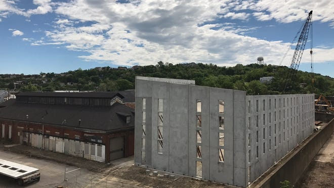 Prefabricated walls for New Riff's new rickhouse have been put in place behind the building at 1050 Lowell St. in Newport.