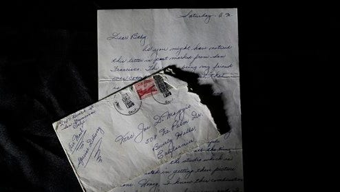 """This Friday photo shows part of a three-page handwritten letter and original envelope postmarked Oct. 9, 1954 from baseball legend Joe DiMaggio to Marilyn Monroe on display at Julien's Auctions in Beverly Hills, Calif.  The letter is among the 300 items that are part of """"Marilyn Monroe's Lost Archives"""" that go up for bid at Julien's Auctions in Beverly Hills on Dec. 5-6."""