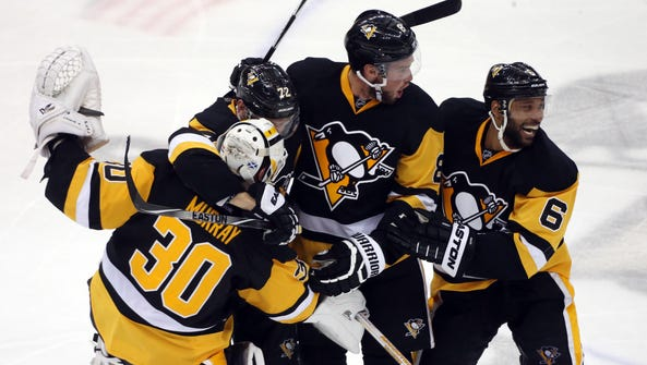 The Pittsburgh Penguins celebrate their Game 6 win