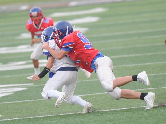Cooper nose tackle Anthony Arellano makes a tackle during the Cougars' spring game at Shotwell Stadium.