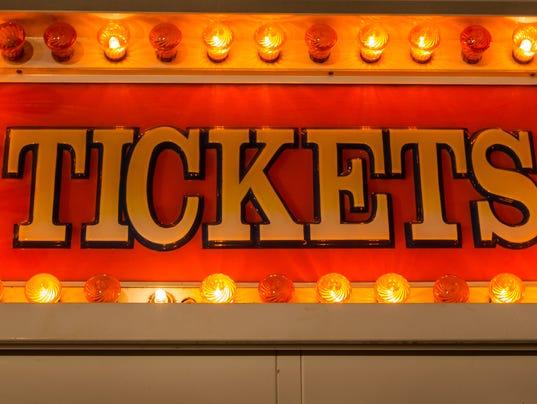 neon ticket sign