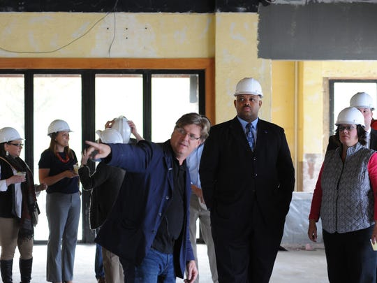 Brett Davis, pointing in foreground, leads a guided tour for media members and guest at Doc's Cantina, which is undergoing renovations. Davis is a partner with the Falls City Hospitality Group.