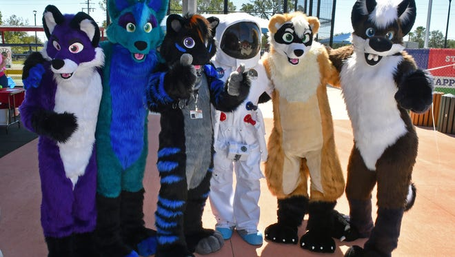 Members of Agents of Mirth cosplayers at the Family Fun Fest hosted by Space Coast Early Intervention Center held at Space Coast Field of Dreams in West Melbourne.