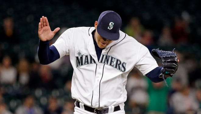 Seattle Mariners starting pitcher Taijuan Walker claps his hands together after striking out Cleveland Indians' Michael Martinez to end the top of the eighth inning of a baseball game Wednesday, June 8, 2016, in Seattle. (AP Photo/Elaine Thompson)