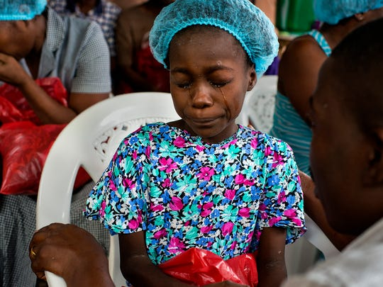 Michel du Cille took this photo of Esther Tokpah, 11, an orphan in Monrovia, Liberia, who lost both parents to Ebola, on Sept. 24. He died Dec. 11, 2014, while on assignment for The Washington Post in Liberia.