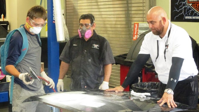 Students gain hands-on training and experience in auto repair at Rancho Mirage High School.