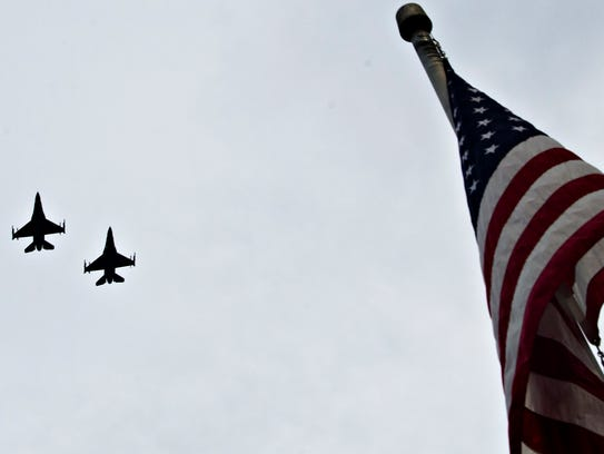 Two F-16's fly over before the Biscuits game on Friday,