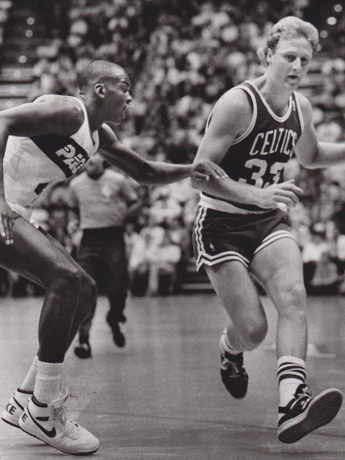Chuck Person guards Larry Bird during an exhibition
