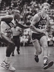 Chuck Person guards Larry Bird during an exhibition game in Terre Haute.