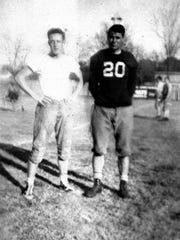 Amos P. Godby (right) was one of the first coaches