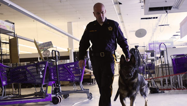 Sgt. Tim Scannell takes Odin, his canine partner, through