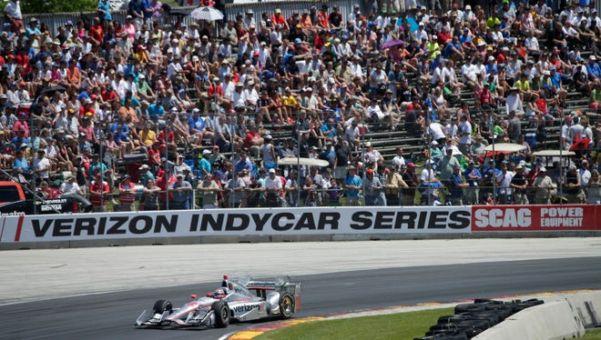 Will Power whizzes by fans en route to victory in the 2016 Verizon IndyCar Series Kohler Grand Prix at Road America.