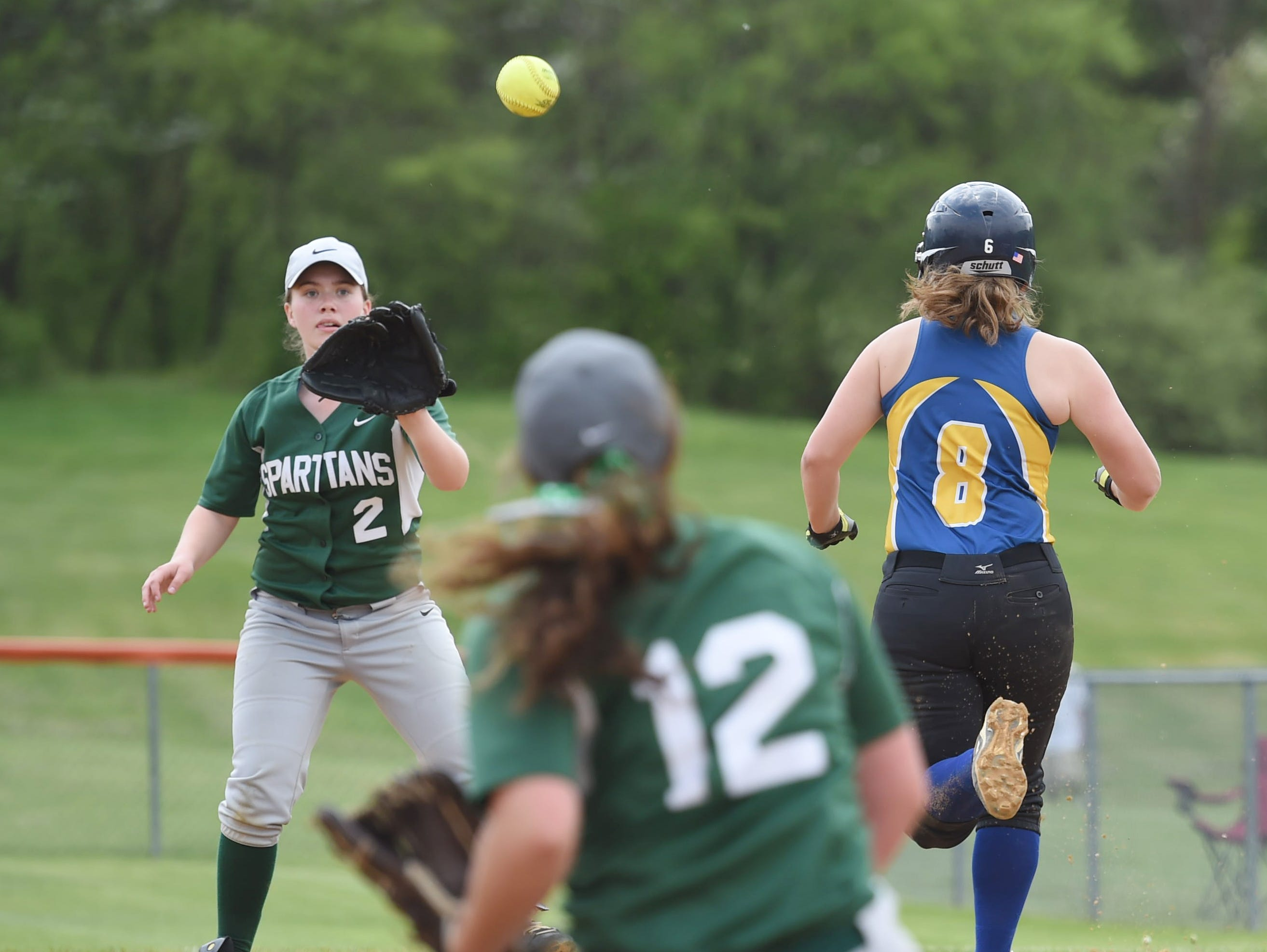 Spackenkill's pitcher, Gabi Mastrantuono recovers a bunt from Ellenville's Mazi Buona and throws to first base, Lexie Close during Saturday's MHAL Division III title game held at Marlboro.