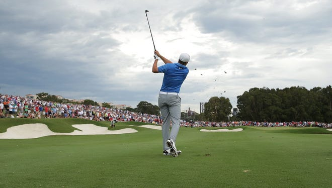 Jordan Spieth of the USA plays his approach shot on the 18th hole during day four of the 2014 Australian Open at The Australian Golf Course on Nov. 30 in Sydney, Australia.