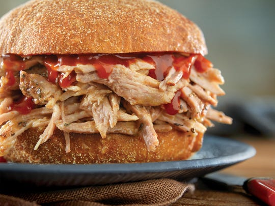 Perfect pulled pork can be served, classically, on