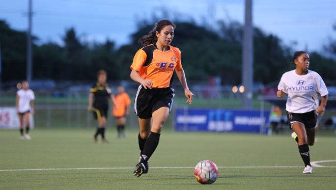Personal Finance Center Lady Crushers' Anjelica Perez looks for an opportunity to take a shot against Hyundai during an opening day match of the 2016 Bud Light Women's Soccer League Fall season on Sunday at the Guam Football Association National Training Center. The Lady Crushers won 13-0.