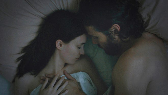 Rooney Mara, left, and Casey Affleck star in David Lowery's 'A Ghost Story,' which premiered Sunday at Sundance Film Festival.