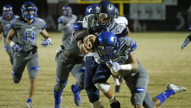 Gilbert Perry's Brock Purdy (13) is hit by Chandler's Cito Hemphill-Toledo (6) on his way to the end zone for a touchdown during the semifinal 6A state playoff game on November 18, 2016 in Chandler, Ariz.
