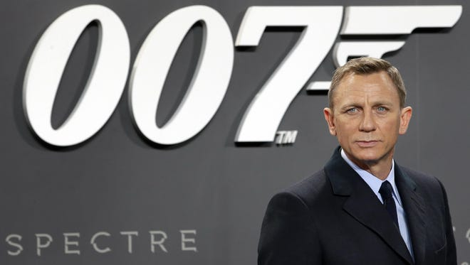 In this Oct. 28, 2015, file photo, actor Daniel Craig poses for the media as he arrives for the German premiere of the James Bond movie 'Spectre' in Berlin, Germany.